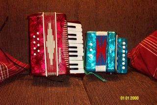 two accordians, one regular size, one child-size